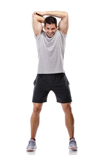 fit, healthy male stretching